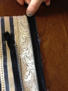 zipper lined up with edge of bag, zipper unzipped.