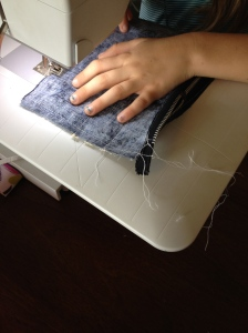 sewing around the bag.